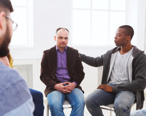 emotional men sitting on the center while doing counseling