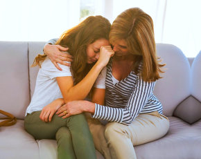 young girl hugging to her mom