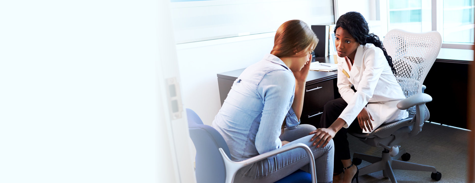 depressed female patient and her consulant in the office